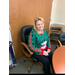 Staff member with holiday sweater