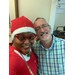 Group selfie of two staff members, one in Holiday outfit