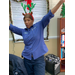 Staff member in holiday reindeer antlers